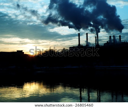 Chemical factory at dawn. Global pollution - stock photo