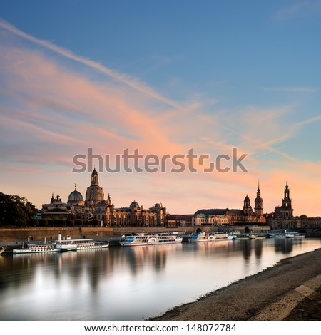 Chemical factory at dawn with rural houses next to it - stock photo