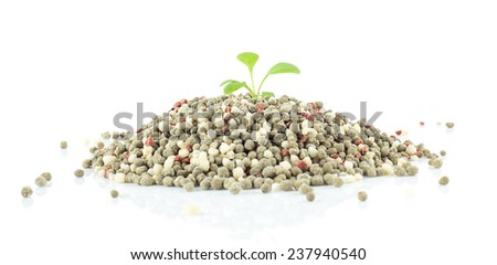 Chemical fertilizer use in agriculture  on white background - stock photo