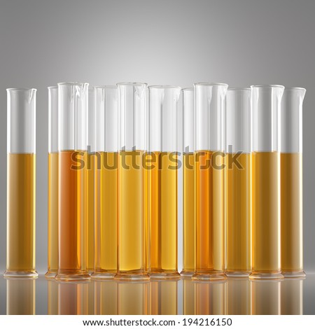 Chemical flask in laboratory with intensive yellow liquid inside, isolated - stock photo