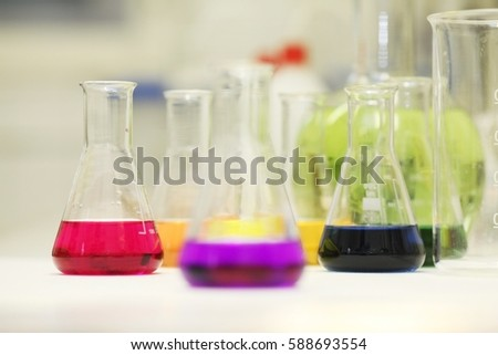 Chemical flask with a blue laboratory test tubes inside,