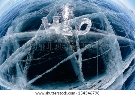 Chemical formula of water H2O made from ice on winter frozen lake Baikal  - stock photo