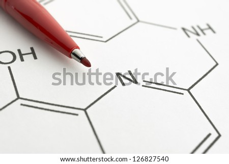 chemical formula with red highlighter pen - stock photo