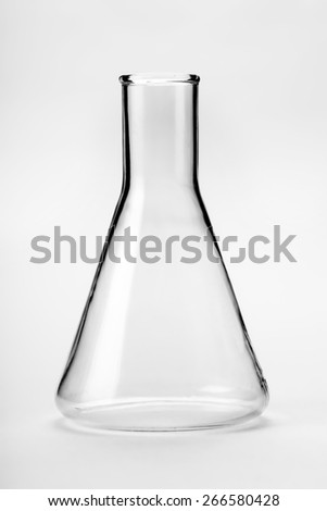 chemical glass flask closeup on a light background - stock photo