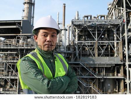 Chemical industrial  engineer wearing safety work standing front of large oil industry