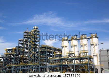 chemical Industrial Plant  against the blue sky - stock photo