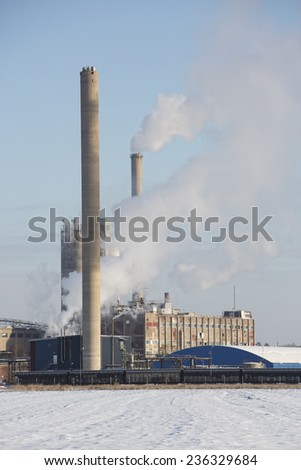 Chemical Industry Building in winter landscape - stock photo