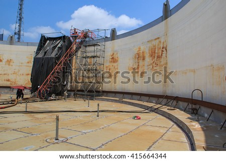 Chemical industry with fuel storage tank cladding Insulation. - stock photo