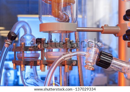 Chemical laboratory glassware background - stock photo
