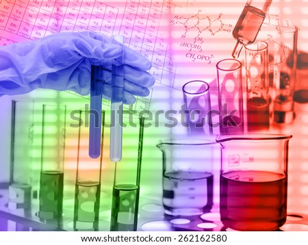 Chemical Laboratory,scientist dropping liquid to test tube - stock photo