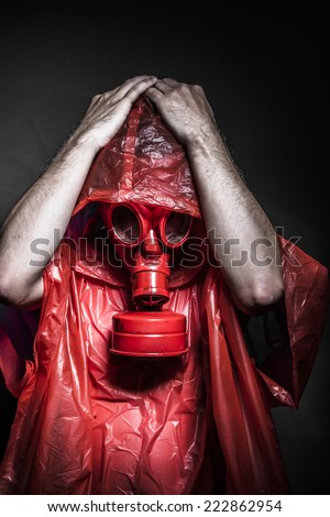 chemical nuclear concept, man with red gas mask - stock photo