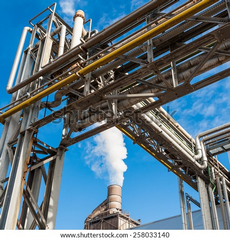Chemical plant for the treatment of chipboard for furniture factory, with chimney - stock photo
