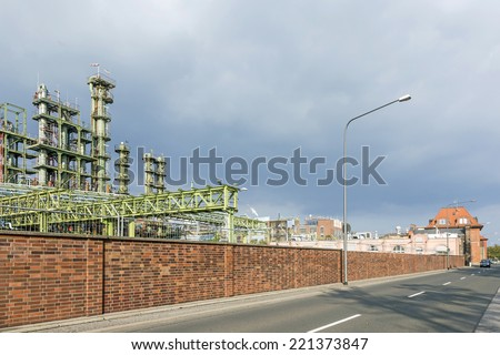 chemical plant in Frankfurt with dark clouds
