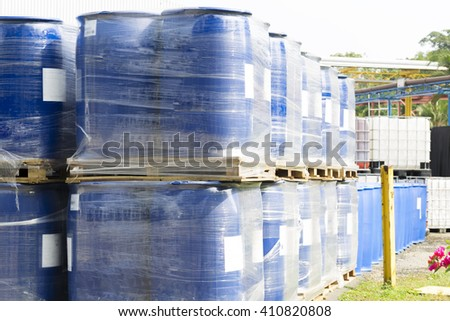 Chemical Plant, Plastic Storage Drums, Big Blue Barrels - stock photo