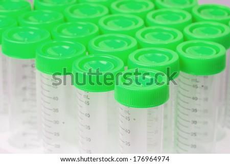 Chemical plastic measuring tubes, studio shot, top view; - stock photo