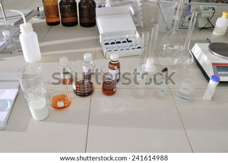 chemical research in the laboratory (many flasks and equipment)