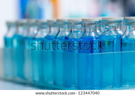 Chemical scientific laboratory stuff test tube and blue glass bottles