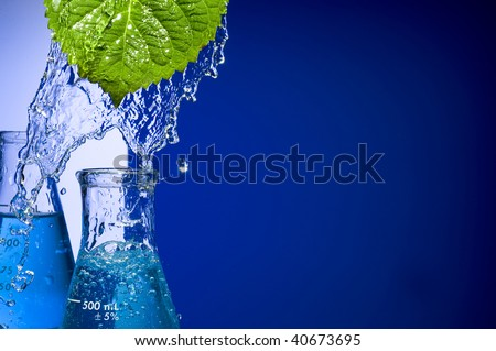 Chemical Test Tube and leaf - stock photo