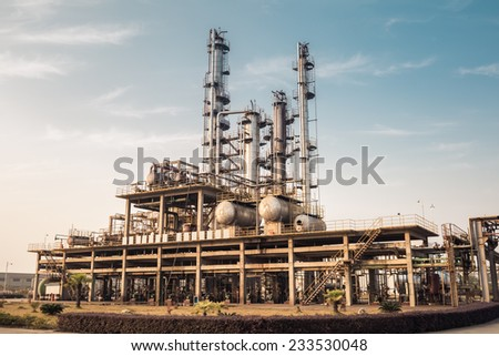 chemicals plant in a dusk sky , industrial landscape  - stock photo