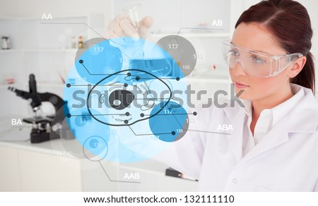 Chemist examining blue cell futuristic interface - stock photo
