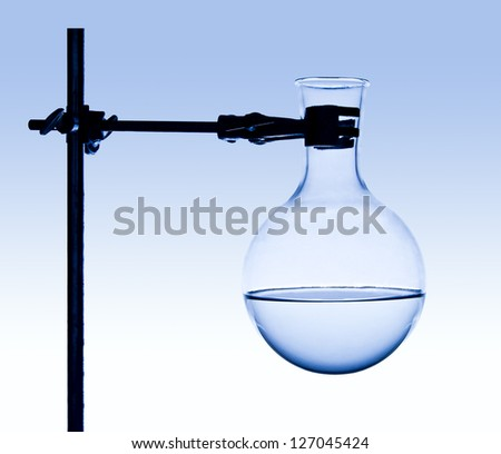 Chemist fixes flask on support - stock photo