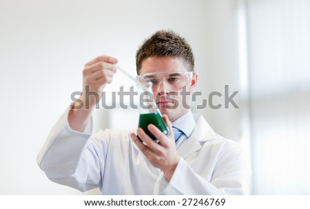 Chemist with a test tube - stock photo
