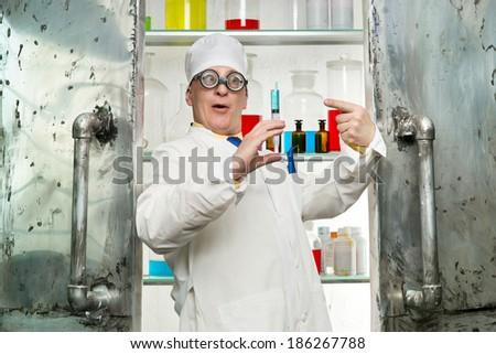 Chemist with syringe in the laboratory - stock photo
