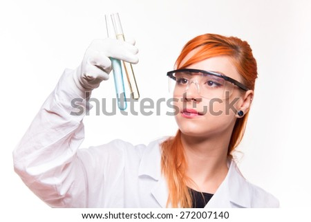 Chemist woman holding a test tube in a lab - studio shoot  - stock photo