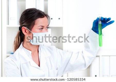 chemist working in laboratory with scientists equipment