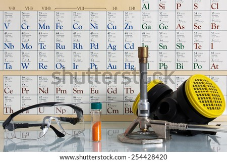 Chemistry equipment and periodic table  - stock photo
