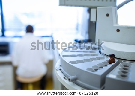 chemistry lab (shallow DOF; focus on the beakers in the foreground) - stock photo