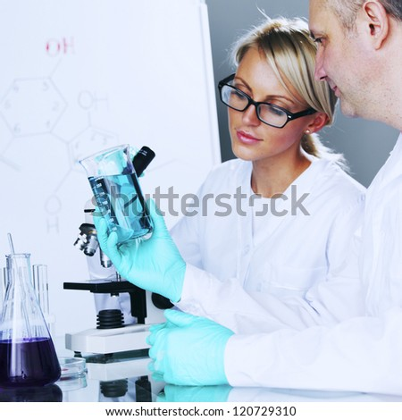 Chemistry Scientist conducting experiments in laboratory - stock photo