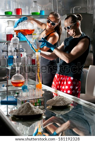 Chemists conduct research in a lab