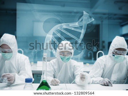 Chemists working in the lab with futuristic interface showing DNA - stock photo