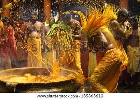 CHENGANNUR, INDIA - APR 03 : Hindu devotees perform the turmeric bathing ritual during the annual festival held at Amman temple on April 03, 2014 in Chengannur, Kerala,India - stock photo