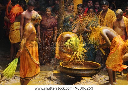 CHENGANNUR, INDIA - MAR 27 : Devotees do turmeric bath ritual during the festival at Vandimala temple on March 27,2012 in Chengannur, Kerala,India. Turmeric bath is an old temple ritual of south India