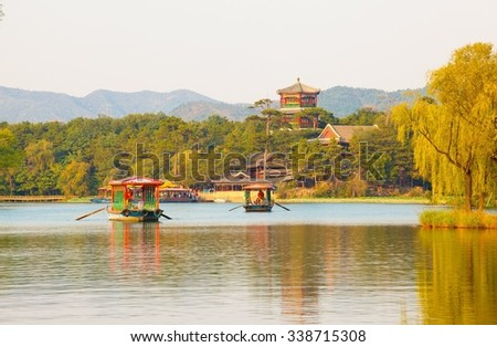 Chengde imperial summer resort scene- Xiaojin Hill under the setting sun. The Resort was Chinaâ??s largest imperial garden. It is located in the city of Chengde, Hebei, China. - stock photo