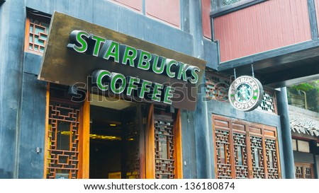 CHENGDU - APRIL 12: Starbucks Coffee coffeehouse on April 12, 2013 in Chengdu,China.Starbucks is the largest coffeehouse company in the world, with 19,435 stores in 58 countries (2012). - stock photo