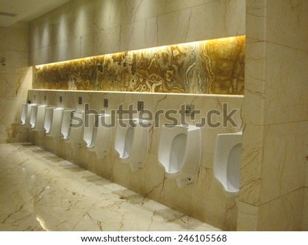 CHENGDU, CHINA - APRIL 2: Mens restroom at New Century Global Center in Chengdu, China, as seen on Apr 2, 2014. The center that houses the mall is the worlds largest building measured by floor space.. - stock photo