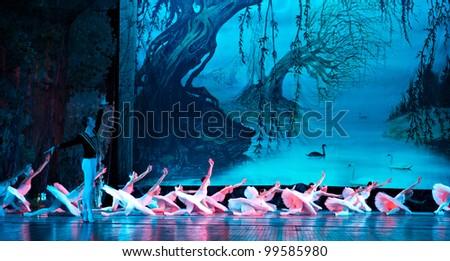 "CHENGDU, CHINA - DECEMBER 25: Russian royal ballet's performance ""Swan Lake"" ballet at Jinsha theater on December 25, 2010 in Chengdu, China. - stock photo"