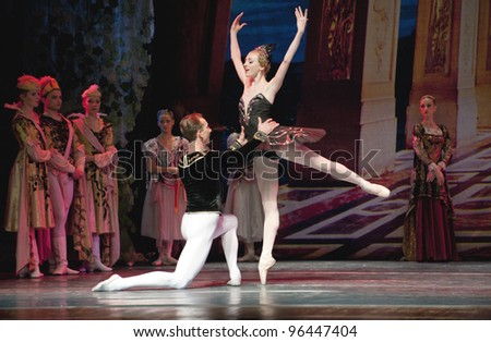 """CHENGDU, CHINA - DECEMBER 25: Unidentified members of the Russian Ballet perform """"Swan Lake"""" at Jinsha theater on December 25, 2010 in Chengdu, China. - stock photo"""