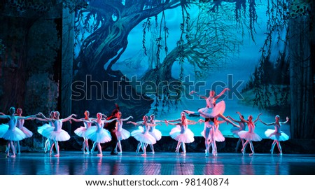 CHENGDU, CHINA - DECEMBER 25: Unidentified members of the Russian national ballet perform Swan Lake ballet at Jinsha theater on December 25, 2009 in Chengdu, China - stock photo