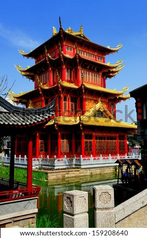 CHENGDU, CHINA: The striking red and gold dragon pagoda with its gilded flying eaves at the Long Tan Water Town - stock photo