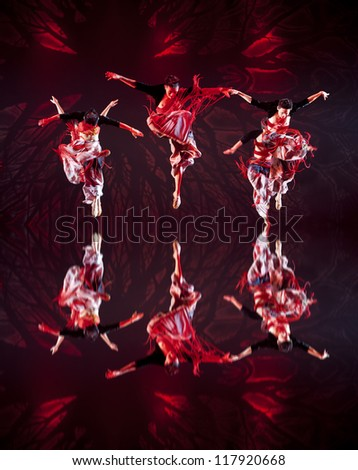CHENGDU - OCT 17: Chinese Yi national dancers perform contemporary dance on stage at JINCHENG theater on Oct 17, 2011 in Chengdu, China.