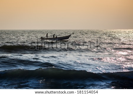 CHENNAI, INDIA-FEBRUARY 10: Fishermen on the beach Marina Beach on February 10, 2013 in Chennai, India. The beach runs from near Fort St. George in the north to Besant Nagar in the south. 13�km. - stock photo