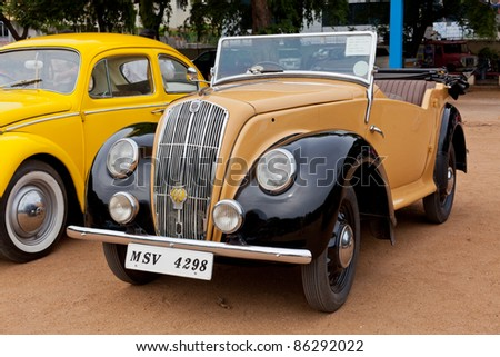 "CHENNAI - INDIA - JULY 24: Morris ""E"" Tourer 1946 (retro vintage car) on Heritage Car Rally 2011 of Madras Heritage Motoring Club at Egmore on July 24, 2011 in Chennai, India - stock photo"
