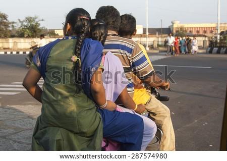 CHENNAI/INDIA 27TH JANUARY 2007 - Family of four on one moped in Chennai India - stock photo