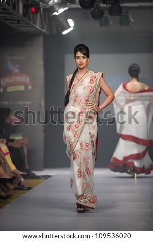 CHENNAI - JULY 21: A model walks on the ramp showcasing Anuradhaa Bisani work during the Chennai International Fashion Week runway on Jul 21, 2012 in Chennai , India. - stock photo