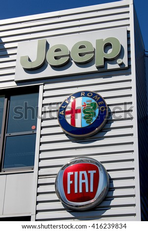 CHENNEVIERES SUR MARNE, FRANCE - MAY 5, 2016: Jeep is an automobile manufacturer Fiat Chrysler Automobiles Group.  Fiat is an Italian car manufacturer.