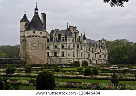 CHENONCEAUX, FRANCE -APRIL 25: On April 25, 2012 visitors brave the elements to visit Chateau Chenonceau. Chenonceau is a manor house built on the site of an old mill located on the River Cher in Chenonceaux, France.